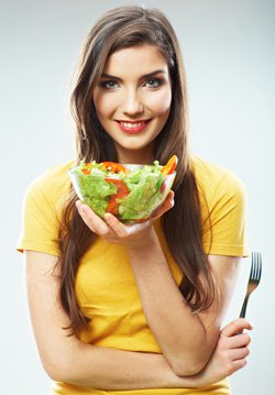 Woman Holding a Bowl of Salad